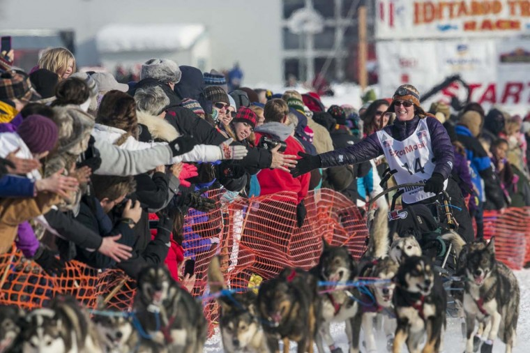 Paige Drobny of Fairbanks heads out of the gate at the re-start of the Iditarod dog sled race in Willow, Alaska March 3, 2013. From Willow, the race runs for almost 1000 miles as it crosses the state. (Nathaniel Wilder/Reuters)
