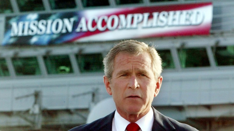 U.S. President George W. Bush declares an end to major combat in Iraq during a speech to crew aboard the aircraft carrier USS Abraham Lincoln as the carrier steamed toward San Diego, California, in this May 1, 2003 file photo. (Larry Downing/Reuters photo)