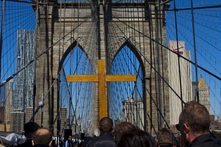 March 29, 2013: People attend the 18th annual 'Way of the Cross Over the Brooklyn Bridge Ceremony' in New York City. The ceremony, hosted yearly on the Christian holy day of Good Friday, includes walking from St. James Cathedral, over the Brooklyn Bridge to St. Peter's Church, in Manhattan. The event attracts approximately 2,000 people each year. (Eduardo Munoz/Reuters)
