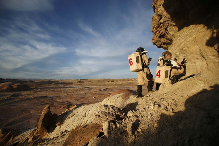 Members of Crew 125 EuroMoonMars B mission collect geologic samples for study at the Mars Desert Research Station (MDRS) in the Utah desert March 2, 2013. (Jim Urquhart/Reuters)
