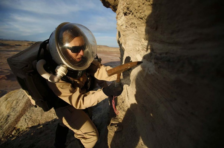 Melissa Battler, a geologist and commander of Crew 125 EuroMoonMars B mission, collects geologic samples for study at the Mars Desert Research Station (MDRS) in the Utah desert March 2, 2013. (Jim Urquhart/Reuters)