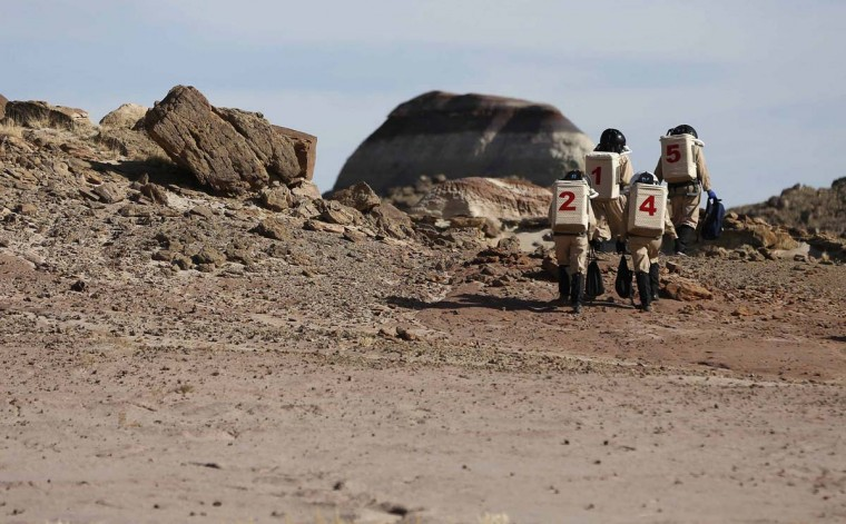 Members of Crew 125 EuroMoonMars B mission venture out in their simulated spacesuits to collect geologic samples for study at the Mars Desert Research Station (MDRS) in the Utah desert March 2, 2013. (Jim Urquhart/Reuters)