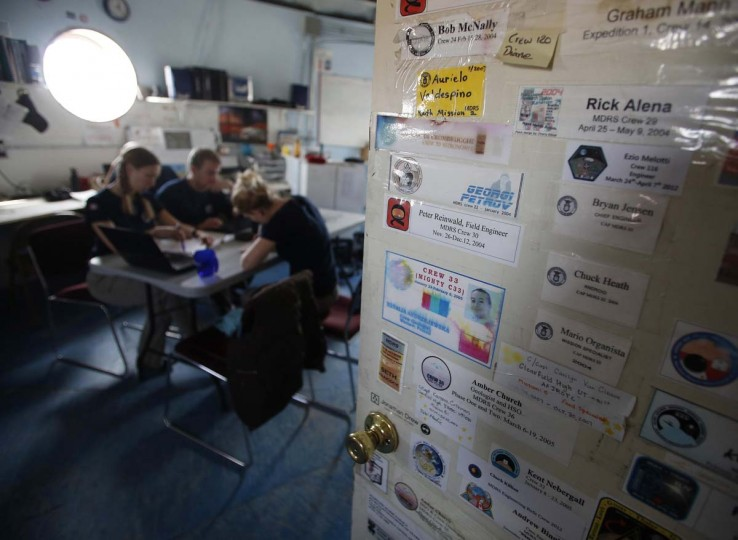 Names of past crew members are stuck on the doors of the crew bunks inside the Mars Desert Research Station (MDRS) outside Hanksville in the Utah desert March 2, 2013. (Jim Urquhart/Reuters)