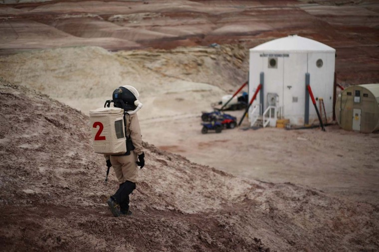 Csilla Orgel, a geologist of Crew 125 EuroMoonMars B mission, makes her way back to the Mars Desert Research Station (MDRS) in the Utah desert March 3, 2013. (Jim Urquhart/Reuters)