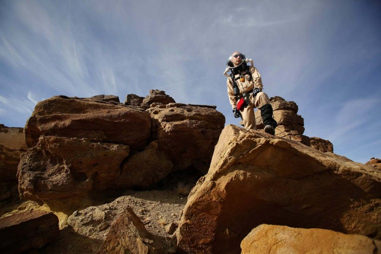 Hans van 't Woud, a mapping researcher and the health and safety officer of Crew 125 EuroMoonMars B mission, collects geologic samples for study at the Mars Desert Research Station (MDRS) outside Hanksville in the Utah desert March 2, 2013. (Jim Urquhart/Reuters)