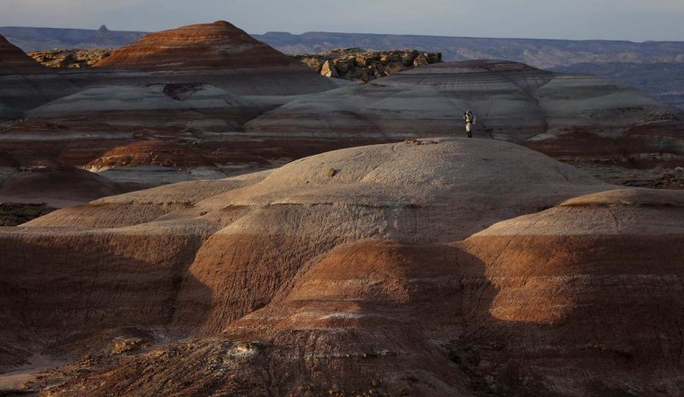 Volker Maiwald, executive officer and habitat engineer of Crew 125 EuroMoonMars B mission, walks among the rock formations while collecting geologic samples for study at the Mars Desert Research Station (MDRS) in the Utah desert March 2, 2013. (Jim Urquhart/Reuters)
