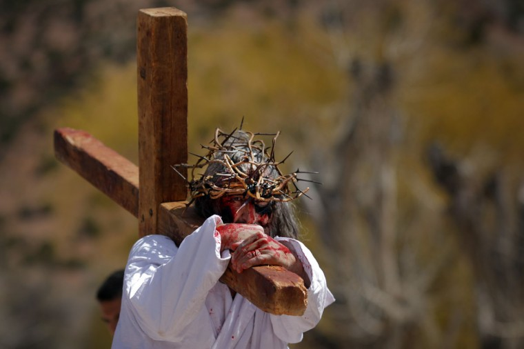 March 28, 2013: A man playing the role of Jesus carries a cross during a re-enactment of the Stations of the Cross at the Sanctuary of Chimayo in Chimayo, New Mexico. (Brian Snyder/Reuters)