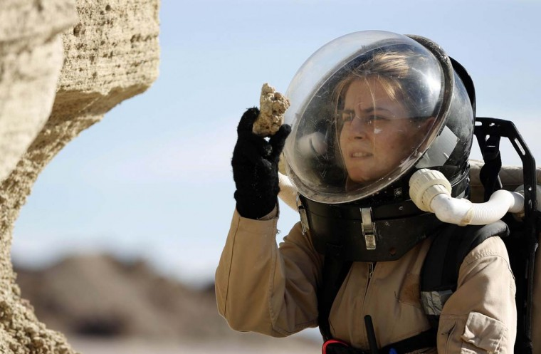 Csilla Orgel, a geologist with Crew 125 EuroMoonMars B mission, collects geologic samples for study at the Mars Desert Research Station (MDRS) outside Hanksville in the Utah desert March 2, 2013. (Jim Urquhart/Reuters)