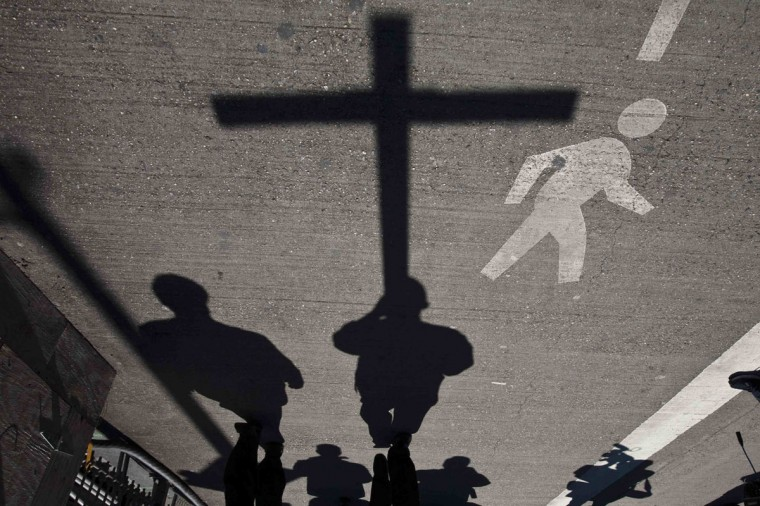 March 29, 2013: People attend the 18th annual 'Way of the Cross Over the Brooklyn Bridge Ceremony' in New York. The ceremony, hosted yearly on the Christian holy day of Good Friday, includes walking from St. James Cathedral, over the Brooklyn Bridge to St. Peter's Church, in Manhattan. (Eduardo Munoz/Reuters)