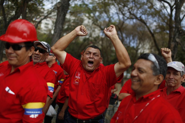 A worker of state-run oil company PDVSA yells a slogan as he waits for his turn to view Venezuela's late President Hugo Chavez's body lying in state at the military academy in Caracas. Tuesday was the last day of official mourning for Chavez, although ceremonies appear set to continue. (Tomas Bravo/Reuters photo)
