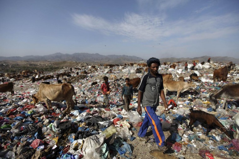 A man walks at a garbage disposal site near the southern Yemeni province of Taiz March 31, 2013. (Mohamed al-Sayaghi/Reuters)