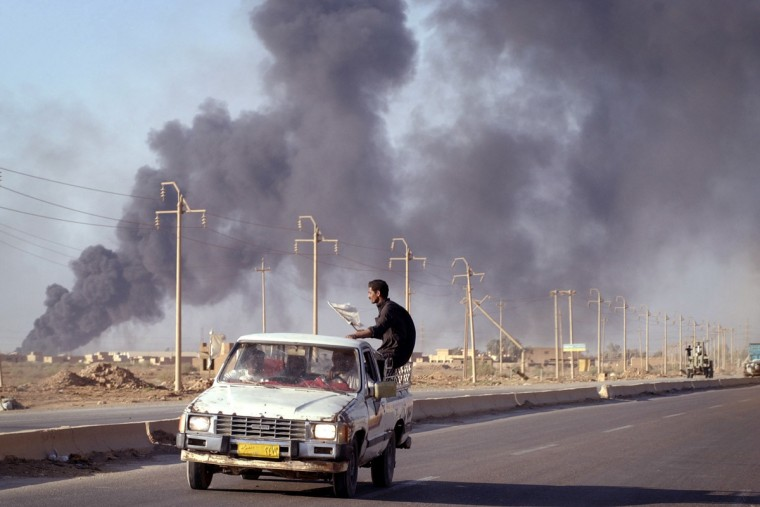 4/11/03 --BAGHDAD -- IRAQ -- Oil fires mar the Bagdad landscape and contribute to the smoke-laden smell of continuing warfare. (Elizabeth Malby/Baltimore Sun)