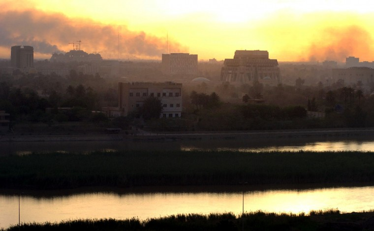 4/12/03 -- The smoke-filled sky overthe Tigris river in Baghdad reflects the light of the setting sun. Artillary and oil fires have created a contant haze throughout the city which stings the eyes and dries the throat. (Elizabeth Malby/Baltimore Sun)
