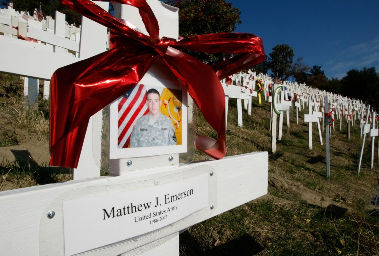 A photograph of Matthew Emerson hangs on one of nearly 4,000 wooden crosses that represent U.S. troops that have been killed in Iraq, at a roadside memorial November 6, 2007 in Lafayette, California. With U.S. military deaths in Iraq surpassing 850 this year, 2007 will be the deadliest year since the U.S. led war in Iraq began in 2003. (JU.S. tin Sullivan/Getty Images)