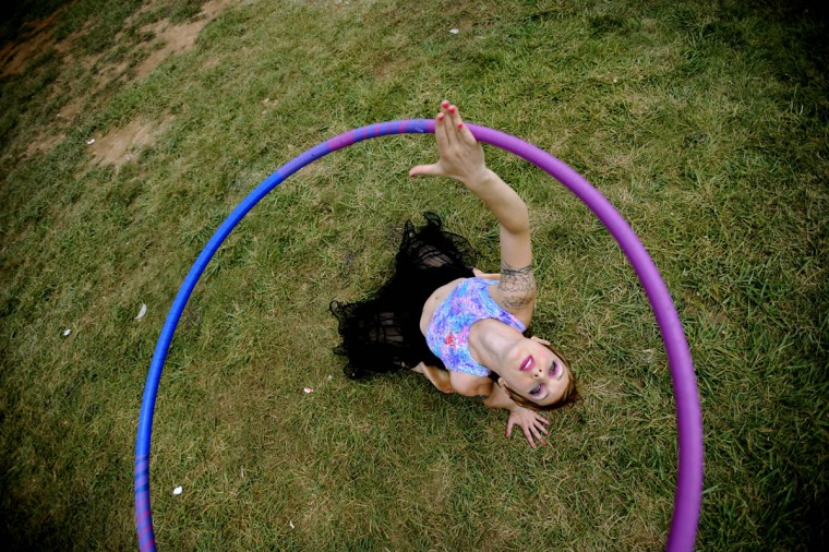 August 9, 2008: Alexis Vasilos uses a hula hoop as she preforms her own act while bands play on the big stage during Virgin Festival. (Monica Lopossay/Baltimore Sun)