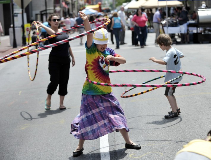 May 12, 2012: Left to right, Meave Gagler, New York, hoops with Gwendolyn Schaffer, 10, and Elliott Schaffer, 7. Gagler is visiting her mother and brought several hula hoops to the 2012 Letís Eat Charles Street Festival along the 300 block of N. Charles Street. The kids are neighbors and live in Baltimore. Gwendolyn recently won a hula hoop competition at her school. (Kim Hairston/Baltimore Sun)