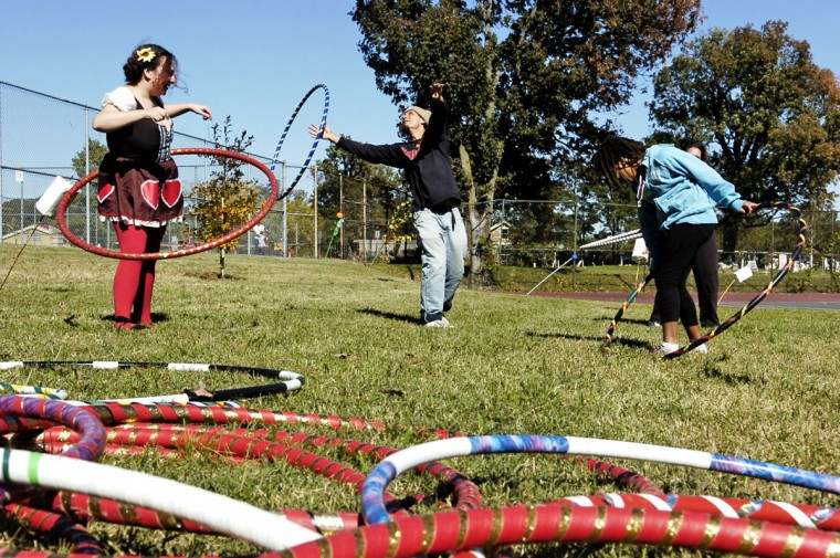 October 16. 2010: Lynda Del Genis, Andreas Spiliadis and Malaika Kaiza enjoy hoola-hooping at the Druid Hill Park 150th Anniversary festival. (Colby Ware/Baltimore Sun)