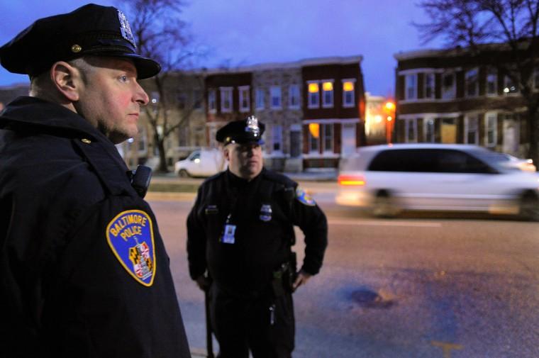 Baltimore City Police Detectives Jim Mingle (left) and Michael Boyd look up and down Fulton Avenue. (Karl Merton Ferron/Baltimore Sun)