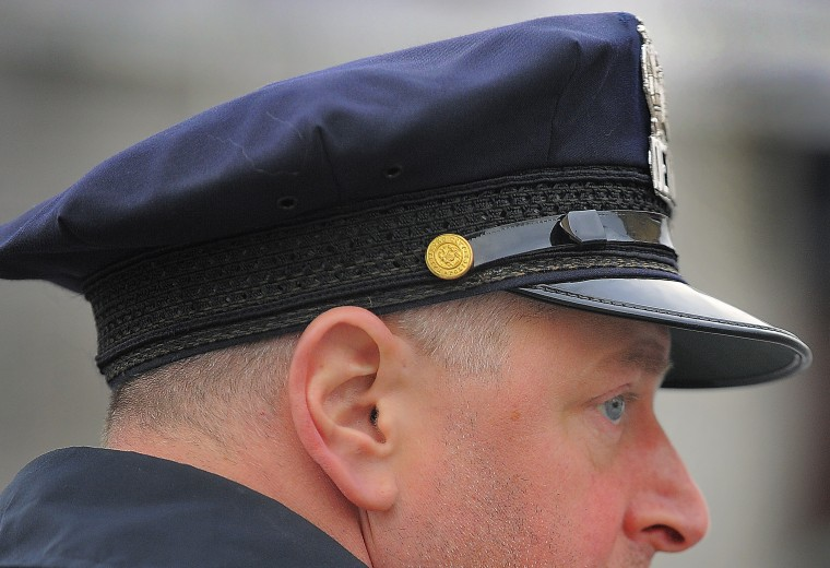 Baltimore City Police Detective Jim Mingle's eyes scan the block. (Karl Merton Ferron/Baltimore Sun)