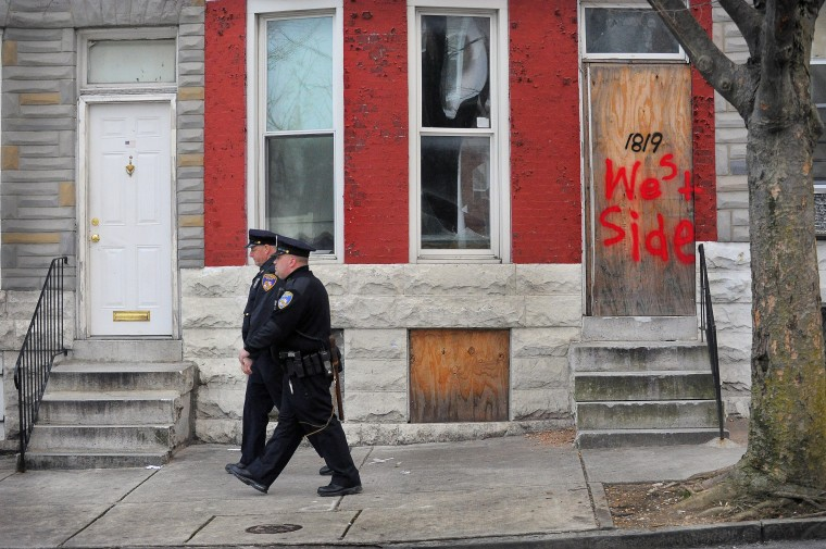 Baltimore City Police Detectives Michael Boyd and Jim Mingle patrol along Walbrook Ave. between Fulton Av. and Payson St. in the city's Western District. (Karl Merton Ferron/Baltimore Sun)