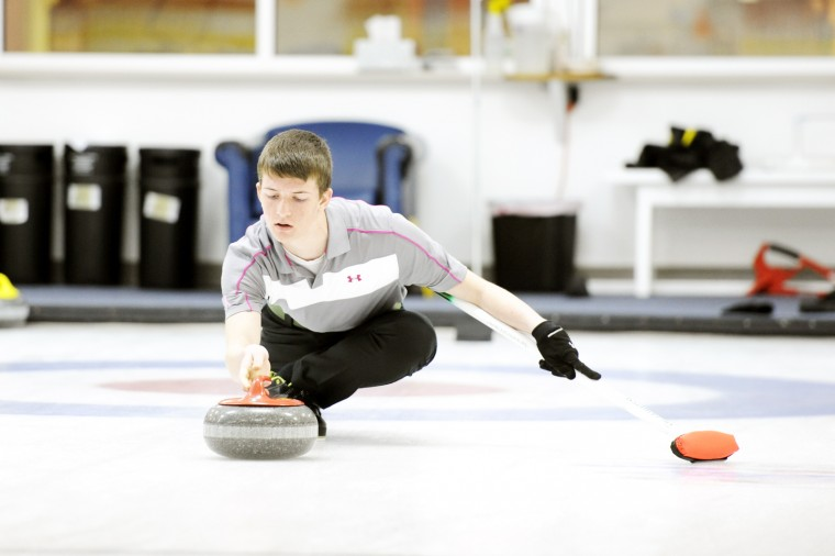 Caleb Clawson releases a stone during a Sunday, March 24 practice for the International Curling Champions. (Jon Sham/BSMG)