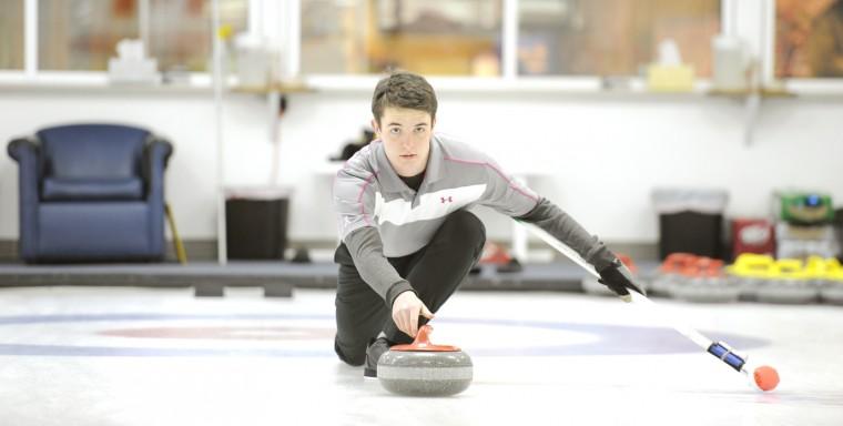 "Hunter Clawson prepares to ""throw"" a stone. (Jon Sham/BSMG)"