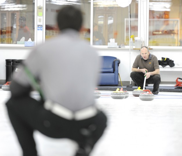 Eric Clawson, right, the brothers' father, also does curling. (Jon Sham/BSMG)