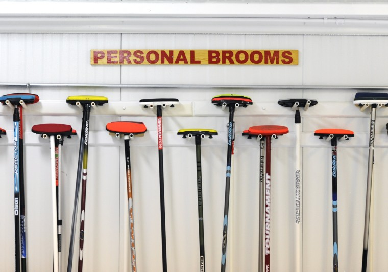 Brooms on the wall at the Potomac Curling Club in Laurel. (Jon Sham/BSMG)