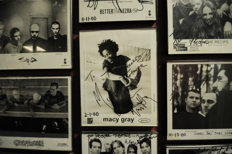 Autographed photos of artists who've performed at the Recher over the years line the walls. At the center here is singer Macy Gray. (Jon Sham/BSMG)