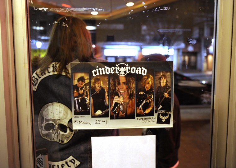 A poster advertising Cinder Road is taped in the window in front of the Recher Theatre. (Jon Sham/BSMG)