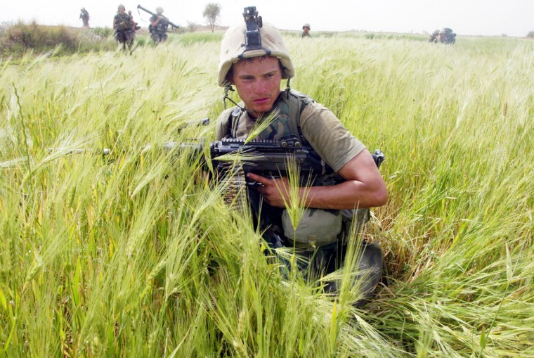 A U.S. Marine from Task Force Tarawa patrols a wheat field in search of enemy combatants or stockpiles of weapons March 31, 2003 in the southern Iraqi city of Nasiriyah. In an announcement on October 21, 2011, U.S. President Barack Obama said in a White House briefing that all U.S. troops would be brought home by the end of the year. (Joe Raedle/Getty Images)