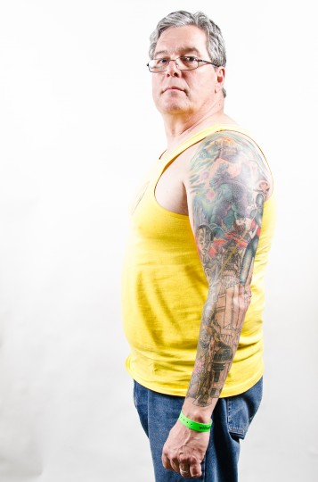 Jeff Singer, 57, New Columbia, PA shows off his arm piece done at Low Tide Tattoo in Jessup, MD at the Baltimore Tattoo Arts Convention in the Inner Harbor. (Josh Sisk/Special To The Baltimore Sun)