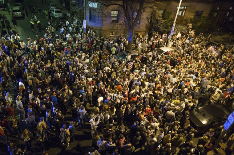 Hundreds of Northeastern University students gather in Hemenway Street to celebrate the capture of suspected Boston Marathon bomber Dzhokhar Tsarnaev in Boston April 19, 2013. As news spread that police had captured Dzhokhar Tsarnaev, the second man suspected of setting off two bombs on Monday at the Boston Marathon, killing three and injuring 176, the streets of Boston and Watertown erupted into thunderous applause and cheers. REUTERS/Scott Eisen