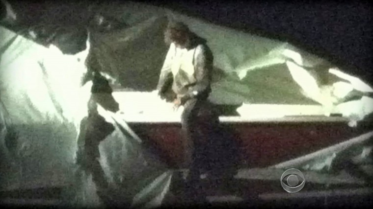 This image obtained April 19, 2013 courtesy CBS News shows Dzhokhar Tsarnaev, a suspect in the Boston Marathon bombing who was captured Friday night, April 19, 2013 after he was found hiding in a boat in a Boston suburb. US police captured an ethnic Chechen teenager suspected of staging the Boston marathon bombings, after a massive manhunt that virtually shut down the city and its suburbs. After a tip from a local resident, police found Dzhokhar Tsarnaev, 19, hiding in a boat in a suburban backyard in Watertown, wounded and weary after a gun battle with police overnight in which his accomplice brother was killed.