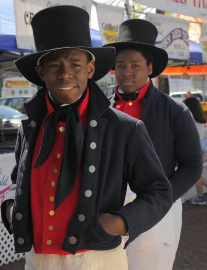 Kaamai Flowers, 13 leads Yair Alston, 13, who are dressed as Baltimore Privateers from Booker T. Washington Middle School during the 2013 Privateer Festival at Fells Point Saturday, Apr. 20, 2013. (Karl Merton Ferron/Baltimore Sun Staff)