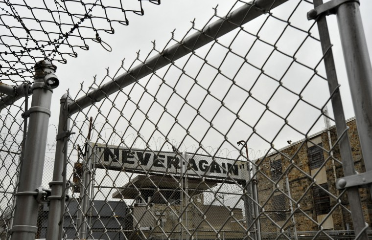 "In 1999, the entrance gate to the Baltimore City Detention Center has ""Never-Again"" emblazoned on the inside, for those leaving the prison. (Amy Davis/Baltimore Sun)"
