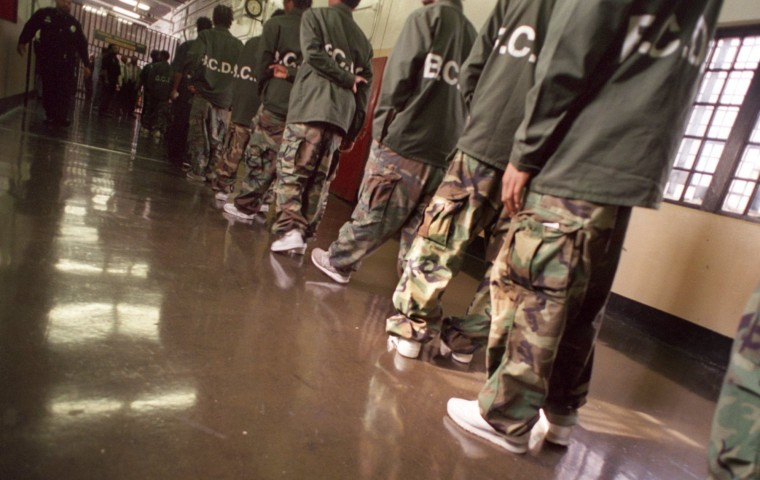 In 2000, juveniles return to their cells. Military style fatigues keep the detainees from developing a competition over designer clothes. (Jed Kirschbaum/ Baltimore Sun)