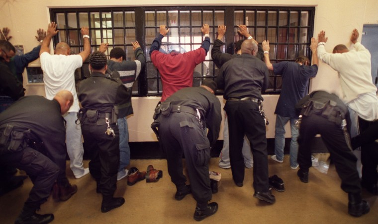In 2002, detainees at the Baltimore City Detention Center (BCDC) get searched by members of the Special Security Unit which has been instituting new search technology in addition to tried and true search methods. (Jed Kirschbaum, The Baltimore Sun)
