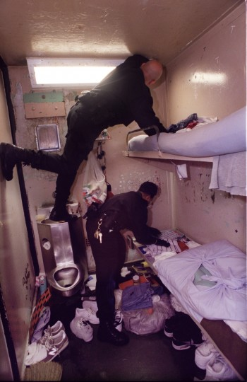 In 2002, at the Baltimore City Detention Center (BCDC) members of the Special Security Unit, Officer Randy Latimer and Officer Cynthia McNeely search a cell, which houses two detainees in the prison's N section, looking for contraband and weapons. (Jed Kirschbaum, The Baltimore Sun)