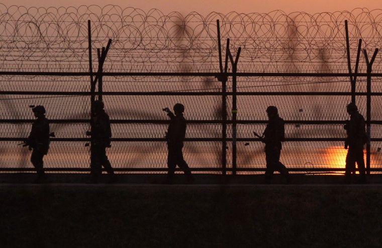 South Korean soldiers patrol inside the barbed-wire fence near the border village of Panmunjom in Paju, South Korea. Still 400 South Korean remain in the joint industrial park fearing they can not get back there once return to South. (Chung Sung-Jun/Getty Images)