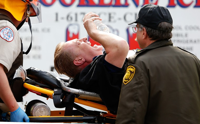 A man is loaded into an ambulance after he was injured by one of two bombs exploded during the 117th Boston Marathon near Copley Square on April 15, 2013 in Boston, Massachusetts. (Jim Rogash/Getty Images)