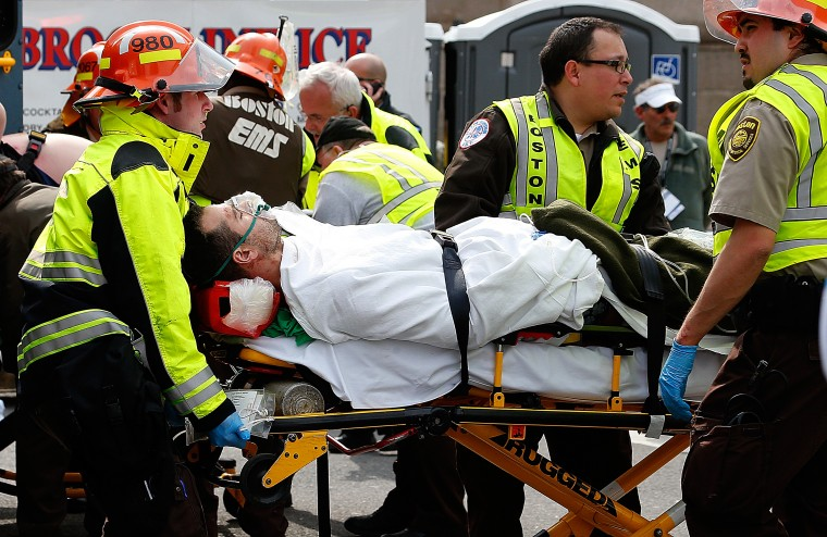 A man is loaded into an ambulance after he was injured by one of two bombs exploded during the 117th Boston Marathon near Copley Square on April 15, 2013 in Boston, Massachusetts. Two people are confirmed dead and at least 23 injured after two explosions went off near the finish line to the marathon. (Jim Rogash/Getty Images)