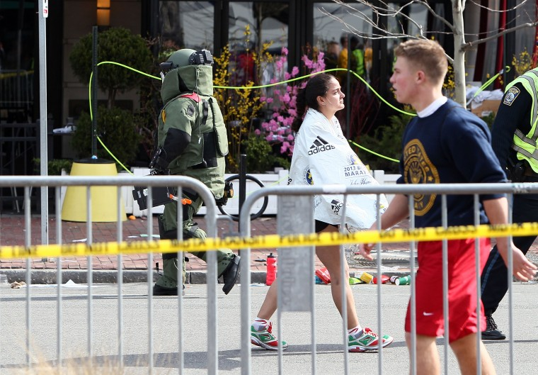 A member of the bomb squad investigates a suspicious item on the road near Kenmore Square after two bombs exploded during the 117th Boston Marathon on April 15, 2013 in Boston, Massachusetts. Two people are confirmed dead and at least 23 injured after two explosions went off near the finish line to the marathon. (Alex Trautwig/Getty Images)