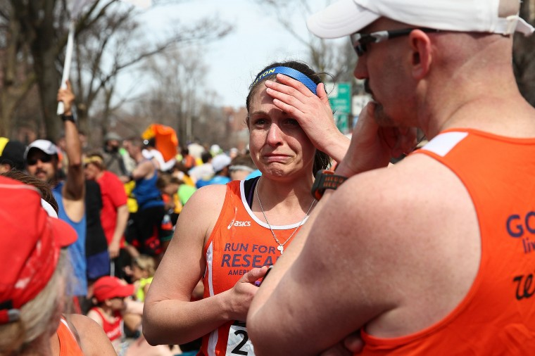 A runner reacts near Kenmore Square after two bombs exploded during the 117th Boston Marathon on April 15, 2013 in Boston, Massachusetts. Two people are confirmed dead and at least 23 injured after two explosions went off near the finish line to the marathon. (Alex Trautwig/Getty Images)