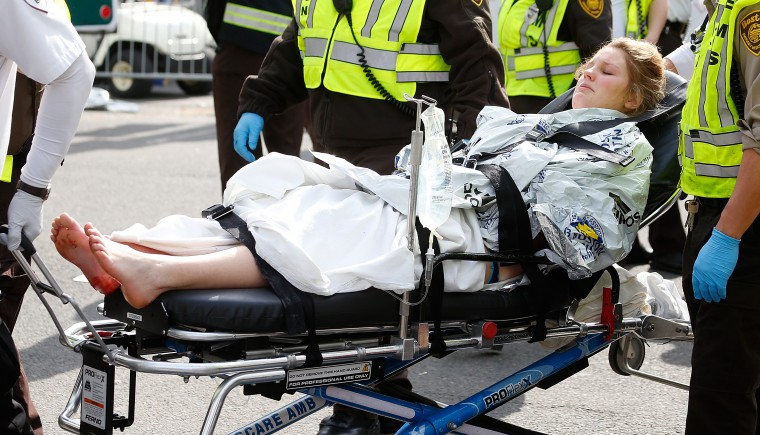 A woman is loaded into an ambulance after he was injured by one of two bombs exploded during the 117th Boston Marathon near Copley Square on April 15, 2013 in Boston, Massachusetts. Two people are confirmed dead and at least 23 injured after two explosions went off near the finish line to the marathon. (Jim Rogash/Getty Images)