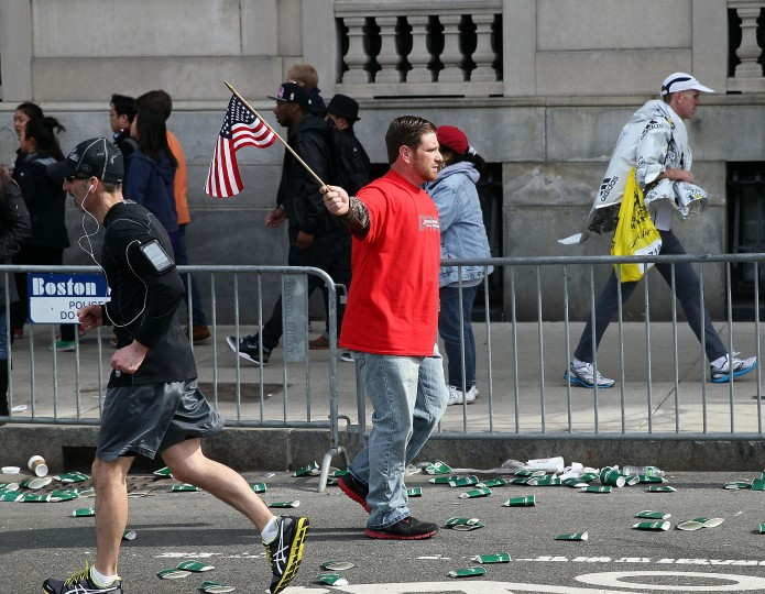 People walk near Kenmore Square after two bombs exploded during the 117th Boston Marathon on April 15, 2013 in Boston, Massachusetts. Two people are confirmed dead and at least 23 injured after two explosions went off near the finish line to the marathon. (Alex Trautwig/Getty Images)