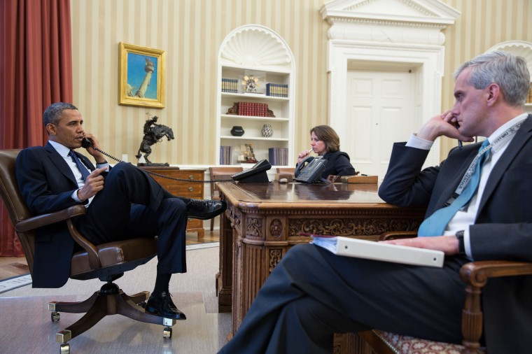 U.S. President Barack Obama, left, talks on the phone with FBI Director Robert Mueller to receive an update on the explosions that occurred in Boston, in the Oval Office of the White House, April 15, 2013 in Washinton, DC. Seated with the President are Lisa Monaco, Assistant to the President for Homeland Security and Counterterrorism, and Chief of Staff Denis McDonough. Two people are confirmed dead and at least 23 injured after two explosions went off near the finish line to the marathon. (Pete Souza/The White House via Getty Images)