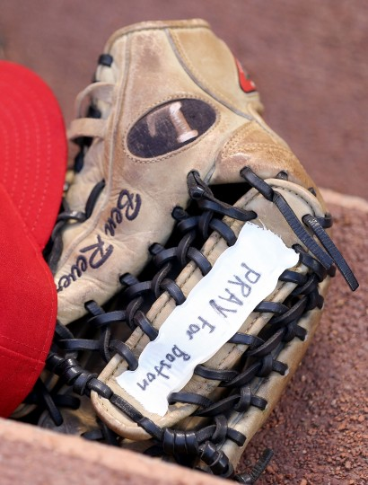 Ben Revere of the Philadelphia Phillies has a message on his glove for the tragedy in Boston during the game against the Cincinnati Reds at Great American Ball Park on April 15, 2013 in Cincinnati, Ohio. All uniformed team members are wearing jersey number 42 in honor of Jackie Robinson Day. (Andy Lyons/Getty Images)