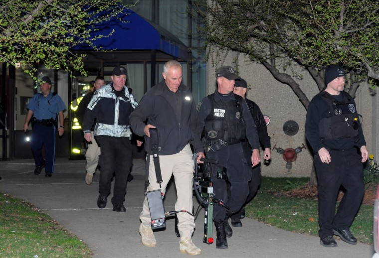 Police and federal officials exit an apartment complex at 364 Ocean Avenue with a possible connection to the earlier expolsions during the Boston Marathon on April 15, 2013 in Revere, Massachusetts. Three people are confirmed dead and at least 141 injured after two explosions went off near the finish line to the marathon. ( Darren McCollester/Getty Images)