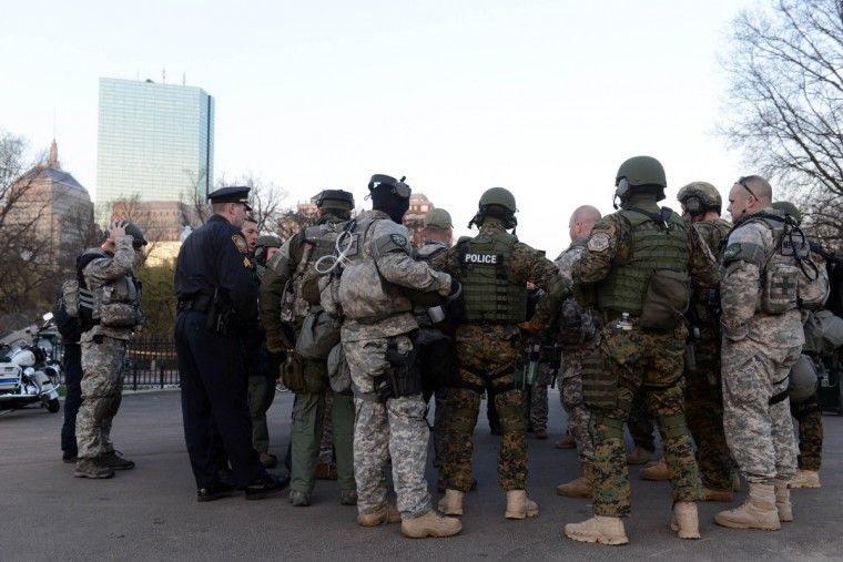 Swat team members and special police units assemble in the Boston Common on April 16, 2013 in Boston, Massachusetts. Security is especially tight in the city of Boston after two explosions went off near the finish of the Marathon, killing three people and injuring at least 141 others. (Darren McCollester/Getty Images)